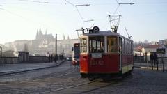 Vintage Tram Passes Over The Bridge In wintry Prague Stock Footage