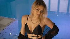 Passionate girl posing in black bra, bikini and robe near basin in 4K Stock Footage