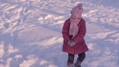 Cheerful child playing in the snow. Stock Footage