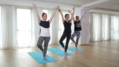 Group of young women doing yoga workout exercise at the gym Stock Footage