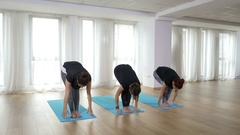 Yoga students doing healthy lifestyle training exercise at the gym Stock Footage