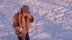 Mother with children playing snowballs. Stock Footage
