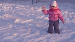A small child playing in the snow. Stock Footage