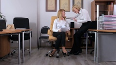 Two girls rejoice in the office Stock Footage