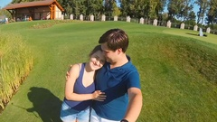 Happy young couple in love making video of themselves at park Stock Footage