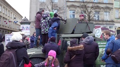 KRAKOW, POLAND -  People examine HMMWV armored vehicle at WOSP Stock Footage