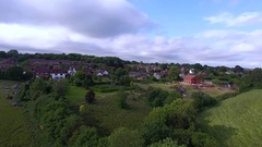 Aerial panning across the East Sussex countryside and rural residential areas Stock Footage