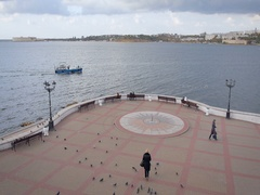 Quay With a Sundial in Sevastopol. People Relax on the Waterfront Stock Footage