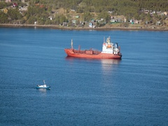 Large Vessel is on the Water, and Small Ship on the Water Quickly Goes. Houses Stock Footage