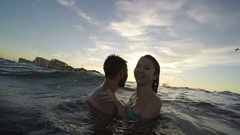 Sweet couple hugging and having fun in the sea Stock Footage