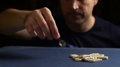 Man set up the domino with hand. Domino effect Stock Footage