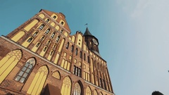 Cathedral building with clock tower in Kaliningrad Kneiphof on summer day Stock Footage