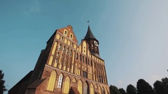 Cathedral construction with watch tower in Kaliningrad Kneiphof under summer sky Stock Footage
