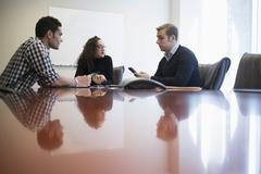 Young business people having meeting in board room Stock Photos