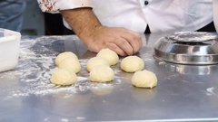 Chef who prepares balls of dough Stock Footage