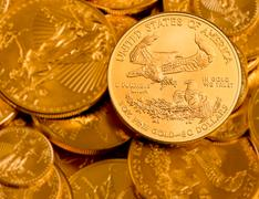 Coin with inscription in GOLD we trust Stock Photos