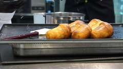 Pastry chef prepares babbà Stock Footage