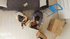 View from the top on young family moving in new house and unpacking boxes Stock Footage