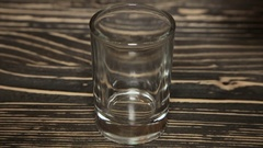 Poured a glass of vodka, close-up . Full hd video Stock Footage