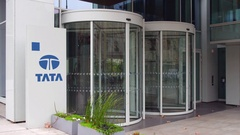 Street signage board with Tata Group logo. Modern office building. Editorial 4K Stock Footage