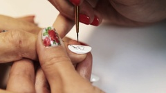 Cosmetic salon manicure session, woman paint heart pattern on white nail polish Stock Footage