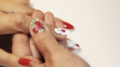 Cosmetic salon manicure session woman paint heart picture on white varnish Stock Footage