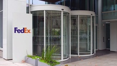 Street signage board with FedEx logo. Modern office building. Editorial 4K 3D Stock Footage