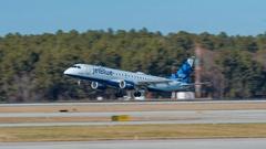 Jet Blue Embraer Airliner Landing at RDU Stock Footage