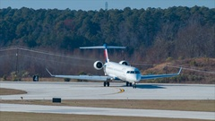 Delta Connection CRJ700 Regional Jet Airliner Taxiing at RDU Airport Stock Footage