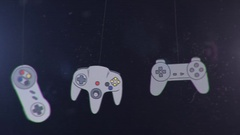 Joysticks of different Game Consoles Hanging and Swinging Stock Footage