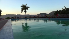 Swimming pool of the Los Jazmines hotel at sunset. Vinales, Pinar del Rio, Cuba Stock Footage