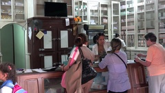 Cubans are in line at the local pharmacy. Vinales, Cuba Stock Footage