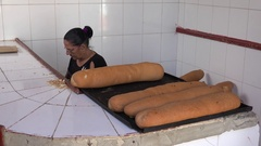 Long loafs with flies in a bakery store at Cuba. Trinidad Stock Footage