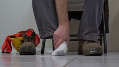 Man Removes Workboot Massages Foot Stock Footage