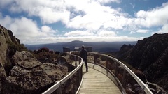 Man walking on Ben Lomond NP boardwalk Stock Footage