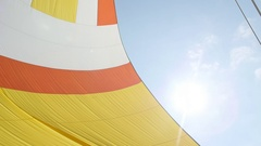Colorful sail on blue sky background on the island of Crete. Stock Footage