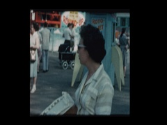 Mother with baby boy in stroller at carnival Stock Footage