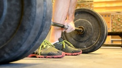Deadlift exercises by middle aged man, detailed low shot 1. Stock Footage