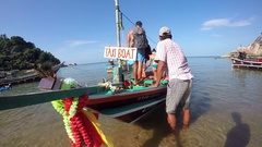 Long Tail Taxi Boat with Tourists on Tropical Beach. Stock Footage