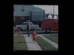 Grandfather watching over toddler grandson Vintage truck drives by Stock Footage
