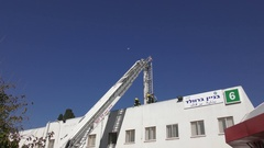 A drone oversees the activity of firefighters on a crane Stock Footage