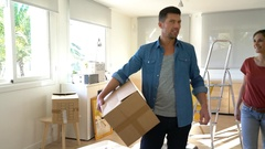 Couple moving in brand new house Stock Footage
