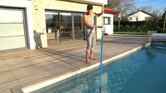 Man cleaning swimming-pool Stock Footage