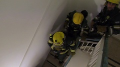 Firefighters go downstairs Stock Footage