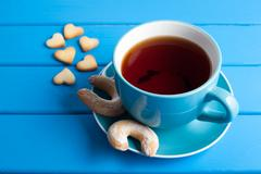 Cup of tea with cookies for Valentine's day. Stock Photos