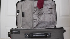 Suitcase packed with neck ties Stock Footage