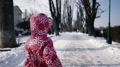 3 Year Old Girl Having Fun and Running by Snow Covered Embankment Alley in Stock Footage