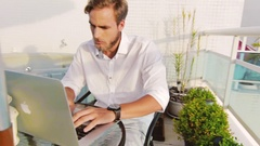 Good Looking Gentleman With A Beard Starting To Work On A Laptop Computer Stock Footage
