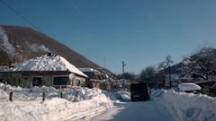 Driving a Car on Rural Country Road in Winter. Snow and Ice on Highway and Near Stock Footage