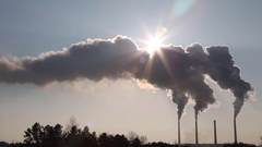 Dense clouds of smoke or vapor out of the three factory chimneys on background Stock Footage